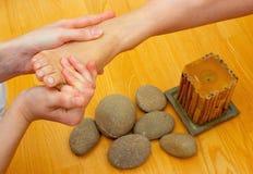 Female feet on massage spa treatment Stock Photography