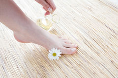 Female feet with oil Royalty Free Stock Photo