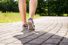 Female Feet On The Sidewalk Closeup Royalty Free Stock Photo