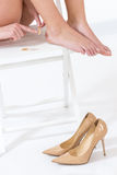 female feet in pain after wearing high heeled shoes Royalty Free Stock Image