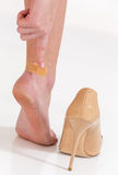 Female feet in pain after wearing high heeled shoes. Female having pain after wearing high heeled shoes Stock Photography