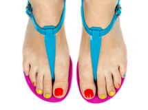 Female feet with a pedicure color Royalty Free Stock Images