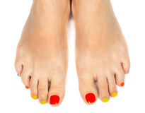 Female feet with a pedicure color. On a white background Stock Photo
