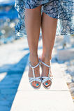 Female feet with a pedicure in a skirt, girl jumping stock images