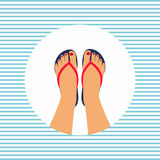 Female feet with a pedicure in the summer flip-flops Royalty Free Stock Image