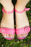 Female feet in pink sandals Royalty Free Stock Photo