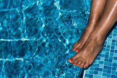 Female feet in pool Stock Photos