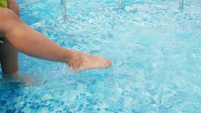 Female feet in the pool stock video