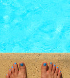 Female feet by the poolside Royalty Free Stock Photos