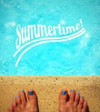 Female feet by the poolside Stock Photo