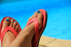 Female feet by the poolside Royalty Free Stock Photo