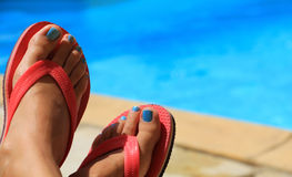 Female feet by the poolside Stock Image