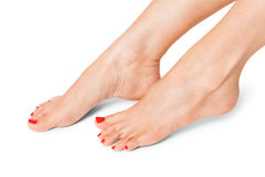 Female feet with red nails Royalty Free Stock Images