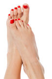 Female feet with red nails stock images