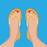Female feet with red pedicure in summer flip-flops Royalty Free Stock Photography