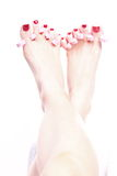 Female feet red polished nails Stock Photography