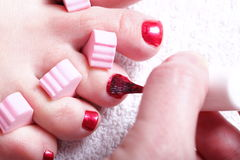 Female feet red polished nails Stock Image