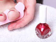 Female feet red polished nails Royalty Free Stock Photo