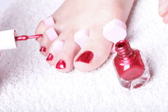 Female feet red polished nails Royalty Free Stock Images