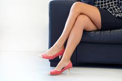 Female feet in red shoes. Criminal prostitution. stock image