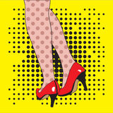 Female feet in red shoes on a yellow background. Royalty Free Stock Photography