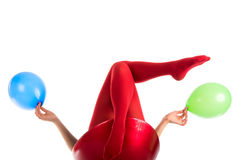 Female feet in red stockings with balloons Royalty Free Stock Images