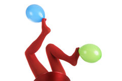 Female feet in red stockings with balloons Stock Image