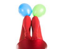 Female feet in red stockings with balloons Stock Photography
