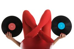 Female feet in red stockings with vinyl record Stock Photo