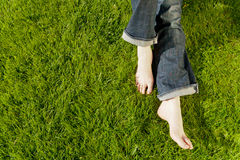 Female feet relaxing on grass Royalty Free Stock Photos