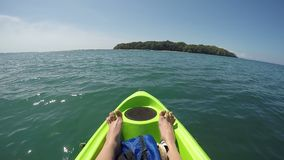 Female feet relaxing on kayak in pacific ocean point of view pov, inspirational landscape, active adventure travel