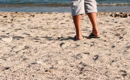 Female feet on sand Royalty Free Stock Images