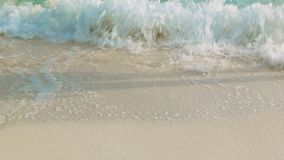 Female feet on a sandy beach in the surf. Video 1080p - Female feet on a sandy beach in the surf stock footage