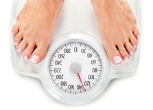 Bare female feet standing on bathroom scale. Female feet scale bathroom stand bathroom scale weight scale royalty free stock photos