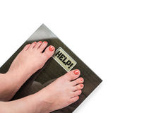 Female feet on scale concept Stock Photo
