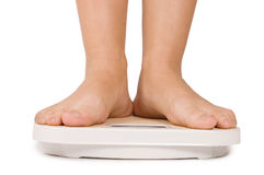 Female feet on scales Stock Image