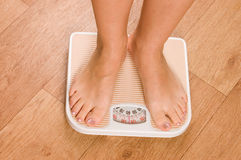 Female feet on scales Royalty Free Stock Image