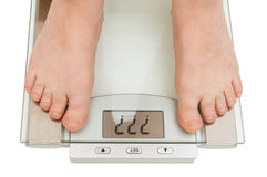 Female feet on scales Stock Photos