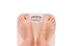 Female feet on scales isolated Royalty Free Stock Photography
