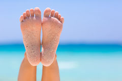 Female feet on sea background. Female feet on blue sky and sea background royalty free stock image