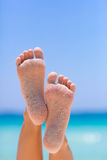 Female feet on sea background. Female feet on blue sky and sea background stock photography