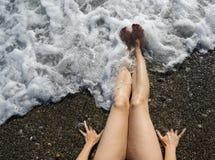 Female feet on the seashore Stock Photo