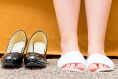 Female feet shod in comfortable slippers Royalty Free Stock Image
