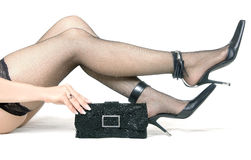 Female feet in shoes and  handbag Royalty Free Stock Photo