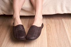 Female feet and slippers Royalty Free Stock Photography