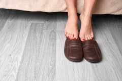 Female feet and slippers Stock Photography