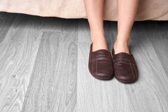 Female feet and slippers Stock Photos