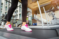 Female feet in sneakers Royalty Free Stock Image