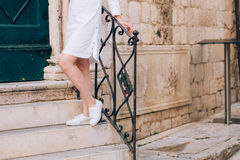 Female feet in sneakers on steps Royalty Free Stock Images