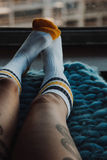 Female feet in socks Stock Photo